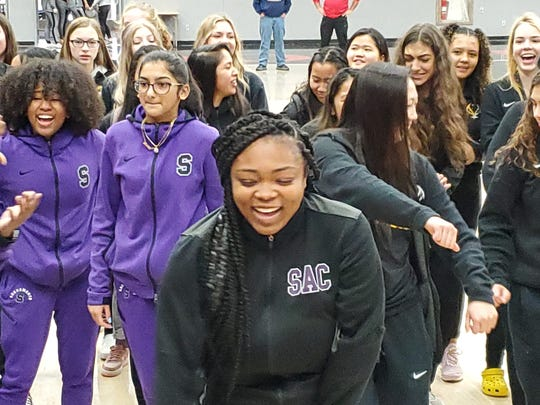 Basketball players from Enterprise and Sacramento High School dance at Foothill High School before playing in the second round of the Harlan Carter Tournament on Dec. 13, 2019.
