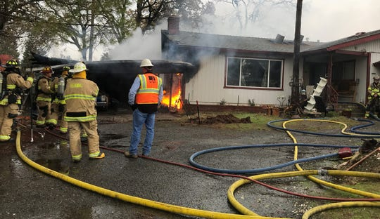 Flames from a house fire on Hawn Avenue are fueled by a gas line leak into the home in east Redding on Friday, Dec. 13, 2019.