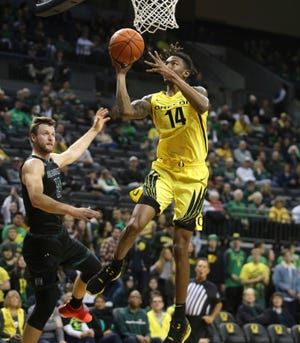 Oregon's C.J. Walker, right, shoots past Hawaii's Zigmars Raimo during the second half of an NCAA college basketball game in Eugene, Ore., Saturday, Dec. 7, 2019.