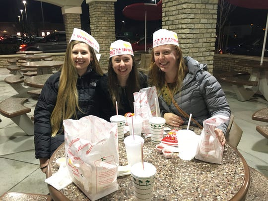 Taylor Kha, 25, Hannah Seagren, 26, Rebecca Laframboise, 28, stood in line for about 2 hours to get their double-double burgers with fries and milkshakes at In-N-Out Burger on Thursday, December 12, 2019.