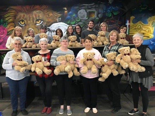 Picture: Bears: (front row) Members of Xi Alpha Nu: President - Juanita Hale, Social Chairman- Wanda Knight. Members: Jean Stewart, Maria Roberts, Susan Owens, Publicity Chairman- Lana Thompson.  (back row) House of Faith Staff and Volunteers.