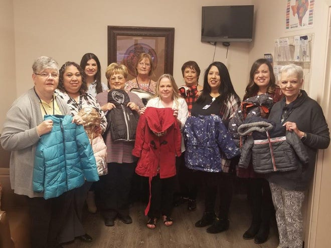 Members of Xi Alpha Nu: Jean Stewart, Susan Owens, Maria Roberts and Wanda Knight with staff members from the Concho Valley Council of Governments: Kathy Bennett, Stephanie Hernandez, Ofelia Barron, Melissa Miranda, Carolina Raymond and Tracy Ogle.