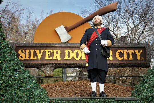 """Robert Montgomery leads the crowd in singing """"We Wish You A Merry Christmas"""" Dec. 13, 2019, at Silver Dollar City."""