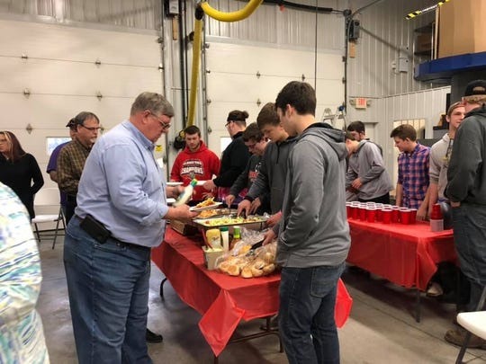 Riverheads football players served dinner to members of the Riverheads Fire Department Sunday, Dec. 8.