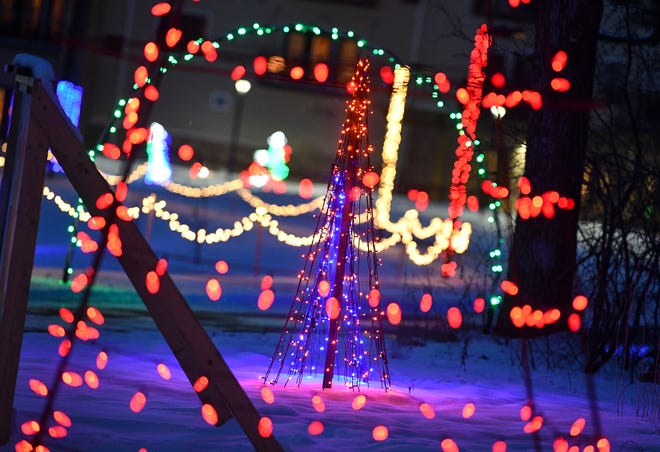 Lights glow on the pathways as part of the Country Lights Festival Wednesday, Dec. 11, 2019, in Sartell.