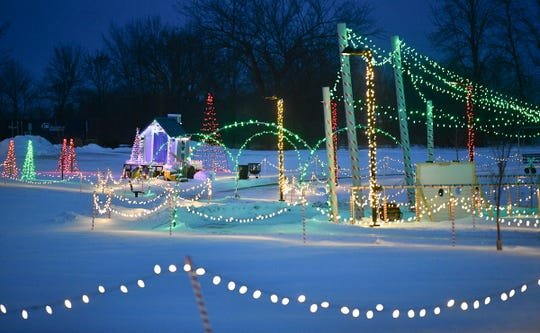 Lights surround the walking paths as part of the Country Lights Festival Wednesday, Dec. 11, 2019, in Sartell.