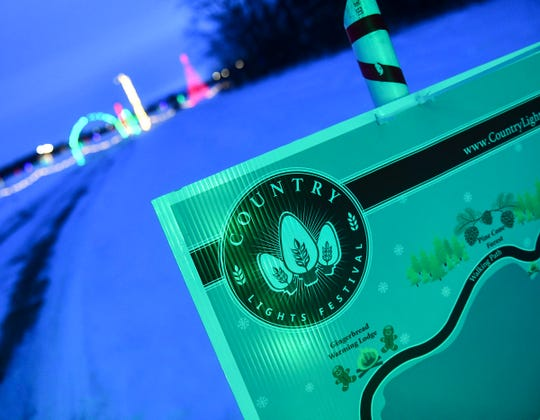 A sign highlights the route of the Country Lights Festival in Sartell.