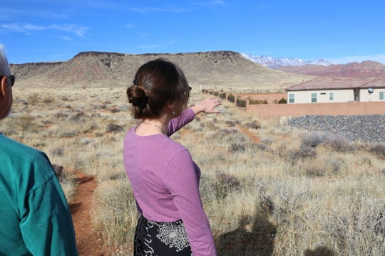 Conserve Southwest Utah Public Lands Program Manager Sarah Thomas points to where the proposed Northern Corridor would begin in Green Springs.