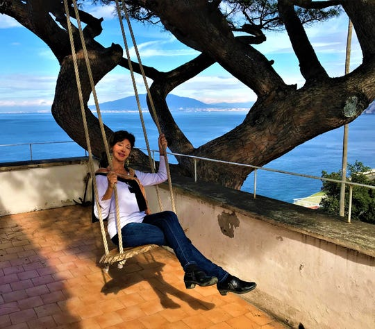 Marina has swing side view overlooking the Bay of Naples and Vesuvius in the background in Sorrento.