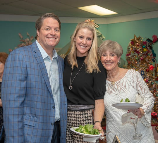 Jack and Michelle Hill and Ellen Peitz at A-Not-So-Silent-Night Cocktail Party and Live Auction at Tykes & Teens Festival of Trees & Lights in Stuart.