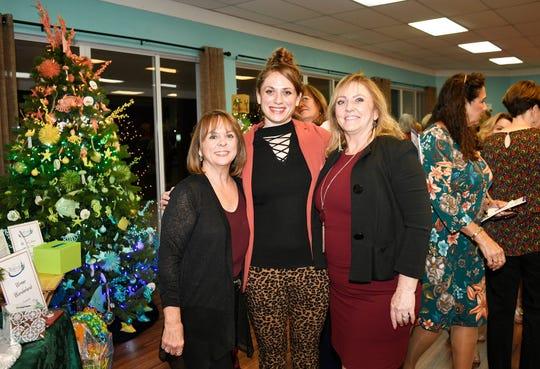 Evie Klaassen, left, Katrina Steier and Candace Lopes enjoy Ladies Night at Tykes & Teens Festival of Trees & Lights in Stuart.
