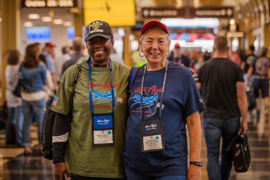 Vietnam War Marine Corps veteran Michelle Wilson, right, of Vero Beach, with her Southeast Florida Honor Flight guardian and Army veteran Sheila Bradley, of Fort Pierce, during the May 2019 Honor Flight.
