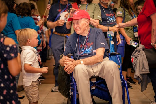 World War II veteran William Beamish Jr., of Stuart, is welcomed home by a young patriot at Palm Beach International Airport during the Southeast Florida Honor Flight in September 2019.