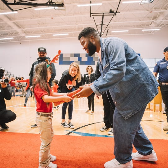 Khalid and his mother, Linda Wolfe,  who is also the executive director of the foundation, concluded the Christmas with Khalid Program with a final distribution of gifts Friday at Del Valle Middle School.