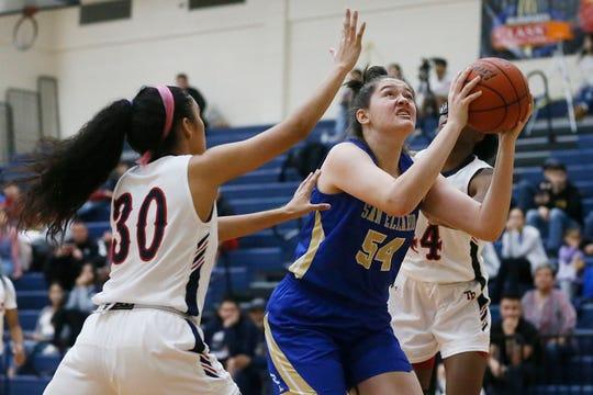 San Elizario's Camila Contreras goes against San Antonio Roosevelt defense in the McDonald's Girls Basketball Tournament Friday, Dec. 13, at Del Valle High School in El Paso.