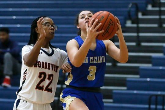 San Elizario's Victoria Perez goes against San Antonio Roosevelt defense in McDonald's Girls Basketball Tournament Friday, Dec. 13, at Del Valle High School in El Paso.