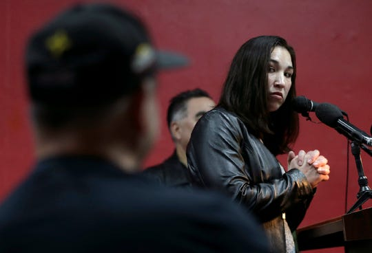 El Paso boxer Jennifer Han looks toward her trainer Louie Burke during a press conference to announce her return to the ring following the birth of her son.