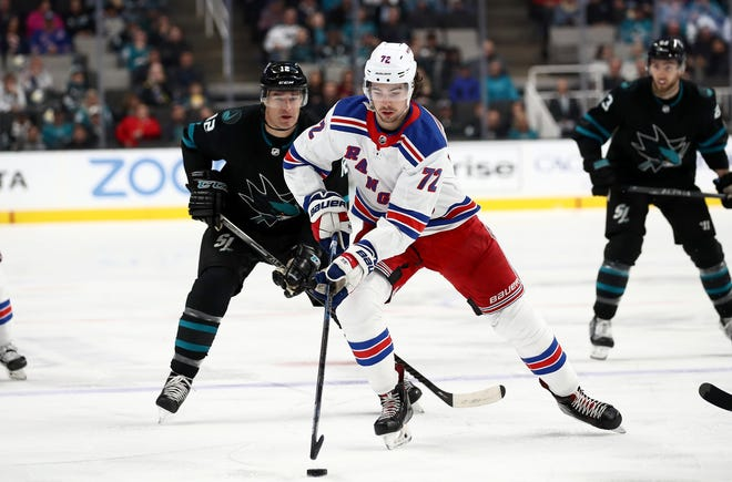 Filip Chytil #72 of the New York Rangers skates away from Patrick Marleau #12 of the San Jose Sharks at SAP Center on December 12, 2019 in San Jose, California.
