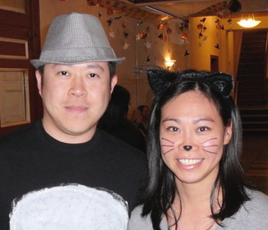 "Chuan-Kai ""Tom"" Liu and Dorothy Liu at a Halloween party in their Queens apartment building about 2011. They and their two children died in a murder-suicide discovered Dec. 5, 2019. Tom Liu killed his family and himself, police said."