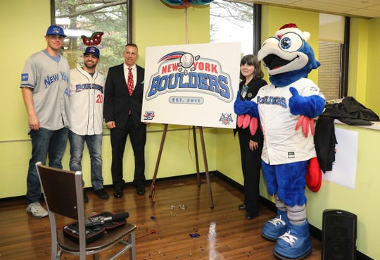 Players Colin Kelly, left, and Alex Fishberg with team president Shawn Reilly Dr. Mary Lahey and Boulder Bird announce the Rockland Boulders name change to the New York Boulders during a press conference at Good Samaritan Hospital in Suffern on Friday, December 13, 2019.