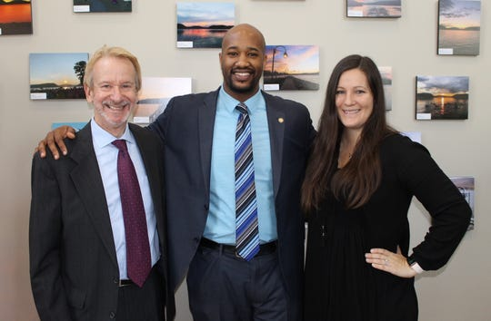From left, outgoing Peekskill City Manager Richard Leins, Mayor Andre Rainey and Shara Hyams, director of marketing, photofinishing at Fujifilm North America Corporation, at the recent opening reception for the Take a Peek: Peekskill Printlife Photo Exhibition in December.