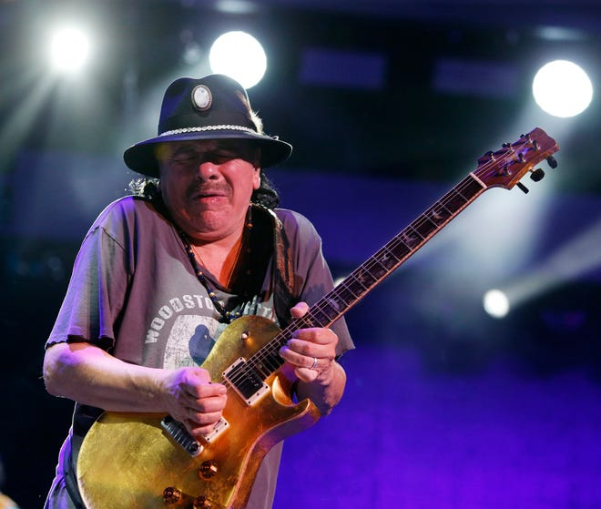 Carlos Santana performs at the 50th anniversary celebration of the Woodstock Festival at Bethel Woods Center for the Arts on August 17, 2019.