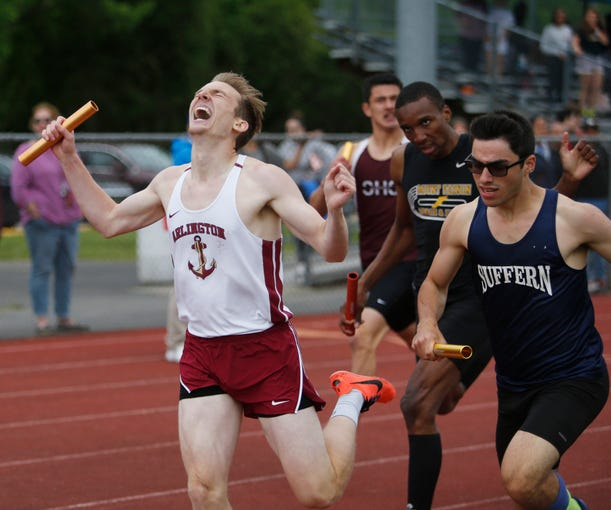 Arlington's Mark Scanlon crosses the finish line while competing a relay race during theSection 1 Class A Track & Field Championship in Freedom Plains on May 23, 2019