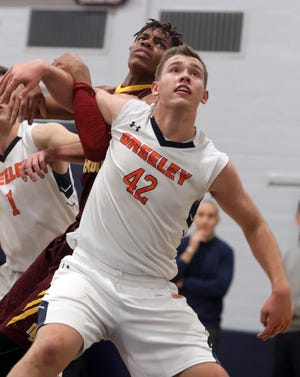 Horace Greeley's Nick Townsend (42) became the first sophomore ever to be named Section 1's Mr. Basketball. He's pictured boxing out Mount Vernon's Troy Hupstead, who was a first-team all-Lower Hudson selection.