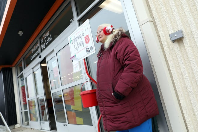 Mary McCartney collects donations for the Salvation Army outside Big Lots in Zanesville on Friday.