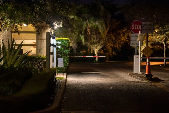 An unidentified G4S guard stands in his post at the entrance to a gated community in Miami