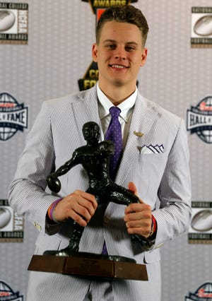 LSU quarterback Joe Burrow poses with the Davey O'Brien Award for being the nation's best quarterback.