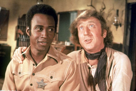 "Cleavon Little, left, and Gene Wilder starred in ""Blazing Saddles,"" a 1974 film directed by Mel Brooks."