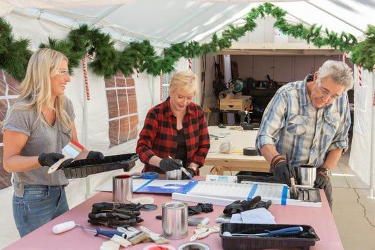 HGTV host Jasmine Roth, left, helps 'Brady Bunch' stars Eve Plumb and Barry Williams turn window shutters into Christmas nutcrackers in 'A Very Brady Renovation: Holiday Edition.'