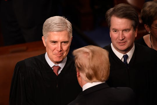 President Donald Trump's two Supreme Court nominees, Associate Justices Neil Gorsuch, left, and Brett Kavanaugh, may play prominent roles in deciding a major abortion case from Louisiana that comes before the court March 4.
