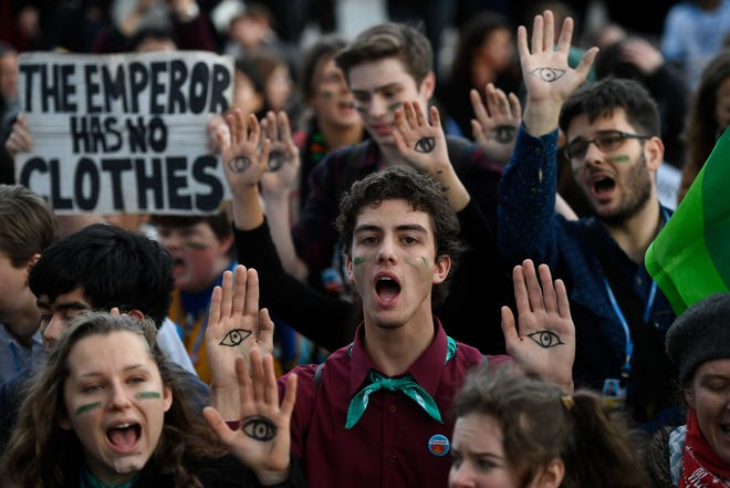Demonstrators take part in a protest on climate emergency, called by environmental groups including Extinction Rebellion and Fridays For Future, outside the UN Climate Change Conference COP25 at the 'IFEMA - Feria de Madrid' exhibition centre, in Madrid, on December 13, 2019.