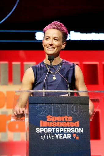 NEW YORK, NEW YORK - DECEMBER 09: Sports Illustrated Sportsperson of the Year Award Winner Megan Rapinoe speaks onstage during the Sports Illustrated Sportsperson Of The Year 2019 at The Ziegfeld Ballroom on December 09, 2019 in New York City. (Photo by Bennett Raglin/Getty Images for Sports Illustrated Sportsperson of the Year 2019) ORG XMIT: 775441660 ORIG FILE ID: 1193012079
