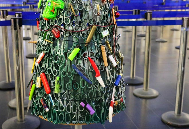 "A ""Christmas tree"" deftly made using items that passengers had to leave behind during screening is on display at Vilnius Airport in Vilnius, Lithuania, on December 12, 2019."