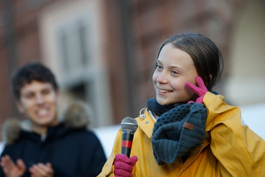 Swedish environmental activist Greta Thunberg attends a climate march, in Turin, Italy, on Dec. 13, 2019.