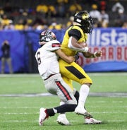 Many defensive back Tackett Curtis (6) tackles Ferriday quarterback Kobe Dillon (1) during the LHSAA Class 2A football state championship game at the Mercedes-Benz Superdome in New Orleans on Friday, December 13, 2019.