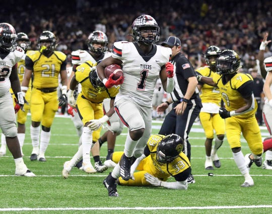 Many running back Terrance Williams (1) scores on this 15-yard touchdown run with 2:42 remaining in the third quarter of the LHSAA Class 2A football state championship game at the Mercedes-Benz Superdome in New Orleans on Friday, December 13, 2019. Williams was named as the Defensive 3-2A Offensive MVP.