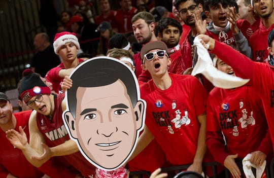 Rutgers fans hold up a Greg Schiano face as they cheer on their team. Seton Hall Basketball at Rutgers in Piscataway, NJ on 12/12/19.