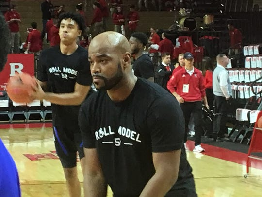 Seton Hall graduate assistant Brandon Hall (foreground), a longtime friend of Eric LeGrand, had the Pirates wearing Roll Model T-shirts during warmups Saturday.