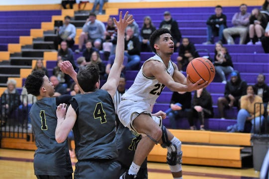 Abilene High's D.J. Modest (23) adjusts in the air while going up for a shot against Seminole during the Gold bracket of the Catclaw Classic at Bulldog Gym on Friday, Dec. 13, 2019. Modest scored 14 points in the Eagles 67-47 victory.