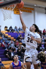 Wylie's Payton Brooks (32) finishes at the rum during the Catclaw Classic Purple bracket game against Cooper at Bulldog Gym on Friday, Dec. 13, 2019. Brooks scored a game-high 15 points in the 45-39 loss.