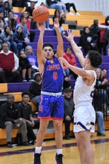 Cooper's Josh Henry (0) takes a shot against Wylie during the Catclaw Classic Purple bracket game at Bulldog Gym on Friday, Dec. 13, 2019. The Cougars came back for the 45-39 victory.