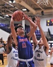 Cooper's Jaelyn Rivera (11) rgoes up for a shot as Midland Christian's Rayshad Chambers (25) and Jonathan Aguirre defend in the first half. The Mustangs beat Cooper 79-46 at the Catclaw Classic on Saturday, Dec. 14, 2109, at Wylie's Bulldog Gym.