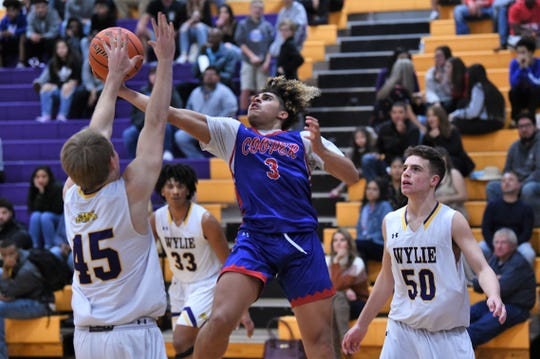 Cooper's Noah Garcia (3) stretches towards the basket for a shot during the Catclaw Classic Purple bracket game against Wylie at Bulldog Gym on Friday, Dec. 13, 2019. The Cougars came back for the 45-39 victory.