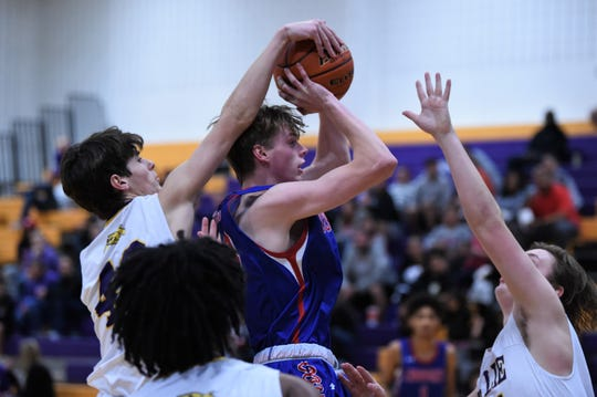 Wylie's Walker Piland (40) blocks an Ashton Curtis (24) shot during the Catclaw Classic Purple bracket game against Cooper at Bulldog Gym on Friday, Dec. 13, 2019. The Cougars came back for the 45-39 victory.