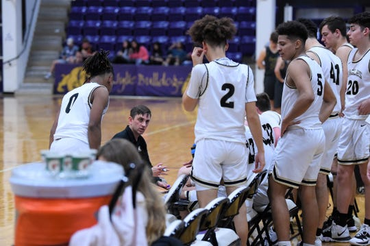 Abilene High coach Justin Reese talks to his team during a timeout at this year's Catclaw Classic. Reese helped lead a 10-win turnaround for the Eagles who returned to the playoffs for the first time since 2016.