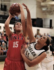 Jim Ned's Alexis Espinosa (15) shoots while being defended by Abilene High's Destiny Potts (11) in the second half.  Jim Ned beat the Lady Eagles 51-22 in the nondistrict game Friday, Dec. 13, 2019, at Eagle Gym.